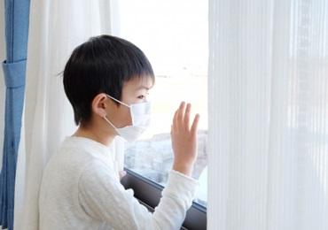 インフルエンザに感染した子供の写真