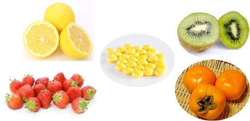 ビタミンCのフルーツと錠剤の画像